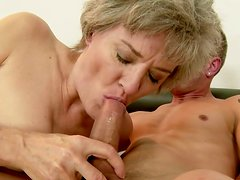 Mature woman with big boobs gives her lover an amazing blowjob