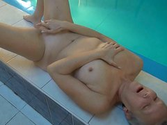 Naked and all alone granny penetrates her own pussy