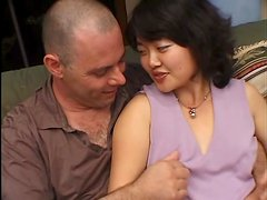 Kimburly blows and gets her hairy Asian vag drilled from behind