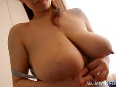 Japanese chick with super huge tits is loving it big