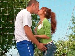 Redhead MILF with big tits gives head and gets eaten outdoors