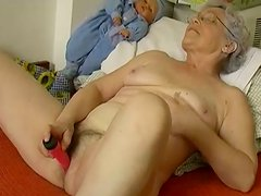 Noble grey haired grandma in glasses diddles her hairy cunt with dildo