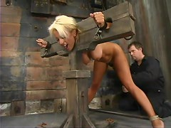 Sexy Stacy Burke gets hog tied and humiliated in a barn
