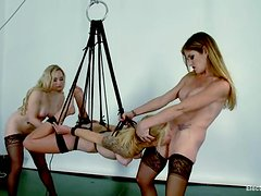 Suspended blonde girl gets toyed by two mistresses