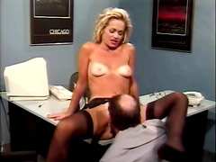 Nice sex in the office with a charming retro chick