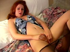 Desirable redhead angel is going to have fun with toys