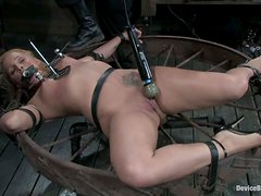 Sara Faye gets pulled by the nipples and fucked with a toy