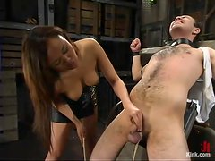 Asian hussy Annie Cruz enjoys torturing Sir C in a basement