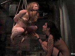 Redhead Madison gets hog tied and toyed in a basement