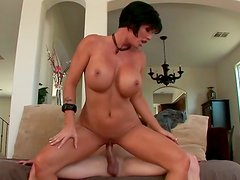 Busty short haired MILF gets boned in missionary position