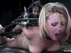 Lexi Belle gets her snatch toyed to orgasm in BDSM clip