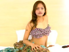 Indian Divya is getting naked and touching her puss