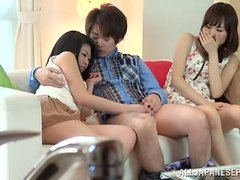 Two slim Japanese girls have hot threesome sex on a sofa