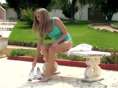 Daring Girl Toys Her Wet Pussy While Sitting Outdoors