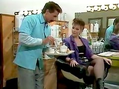 Two guys serve ladies at the highest level in the hairdressing salon