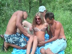 Cute Russian babe with small tits is fucked bad gangbang in the forest