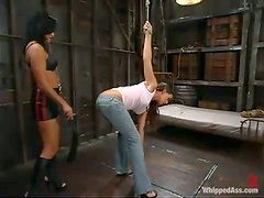Penny Flame plays BDSM games with Sandra Romain in a foul basement