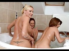 Horny ladies share a big cock in a hot foursome