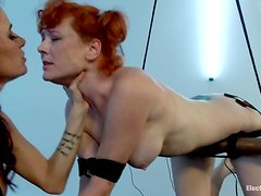 Redhead Audrey Hollander gets her ass stimulated with electricity