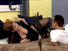 Mature slut Nancy sucks and rubs a cock and enjoys doggy style banging