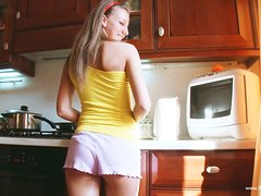 Sexy, Naughty Girl Fingering Her Pussy in the Kitchen
