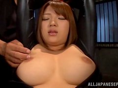 Latex asian hottie plays with a vibe and gets fingered.