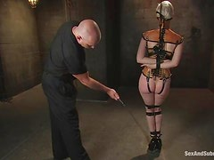 Blond slave Cherry gets trapped in the weird fetish costume