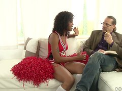 Lotus Lain the ebony cheerleader fucks White dude on a sofa
