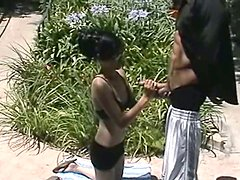 Skinny Asian girl in glasses gives a handjob outdoors