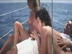 FFM threesome with two curvy retro babes on the boat
