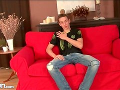 Twink fondles his feet and strips naked