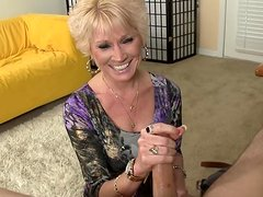 Short-haired blonde milf is wanking a dick