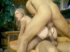 Slut in stockings is sandwiched between two well-endowed dudes