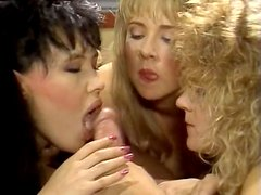 Reverse gang bang of one dude getting blowjob from three babes