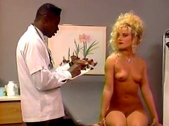 Black gyno doc gets horny while examining wet pussy of white babe