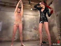 Hot mistress in latex tortures a guy with claws and drills his ass