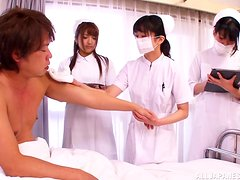 Asian nurse Shiori Kamisak sucks on a patient's hard cock