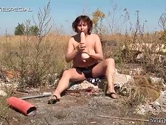 Hairy Hitch Hiking MILF Taking a Huge Dildo and a Cock Outdoors