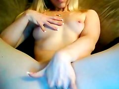 Horny blonde babe plays with her slick pussy on webcam