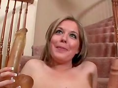 Haley Scott plays with a realistic dildo on the stairs