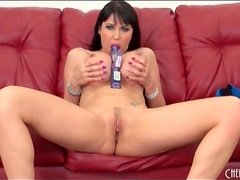 Milf with big round fake tits masturbates