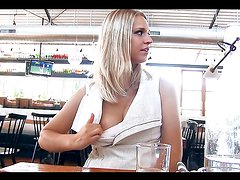 Gorgeous blonde teen pops her tits in a diner