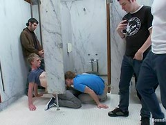 Handsome twink gets tortured and fucked in a public bathroom