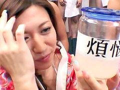 Japanese cutie is swallowing sperm from bottle