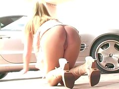Delightful blonde babe shows her nice pussy at a parking