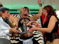 Femdom lesbian threesome with chained blonde
