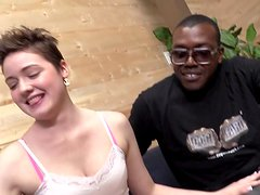 Emma Snow strokes and sucks two big black cocks in a backstage
