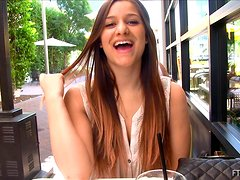 Long haired beauty is talking naughty at lunch