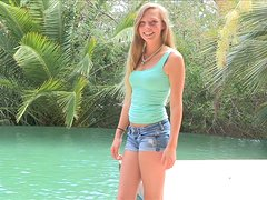 Marlie the playful blonde poses naked by the pool