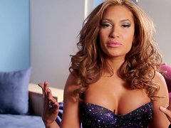 Horny Reby Sky shows her nice boobs lying on a nightstand